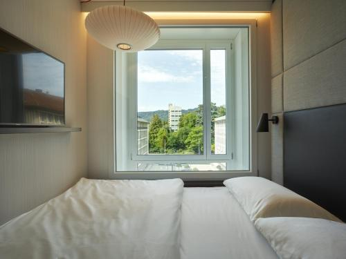 A bed or beds in a room at citizenM Zürich