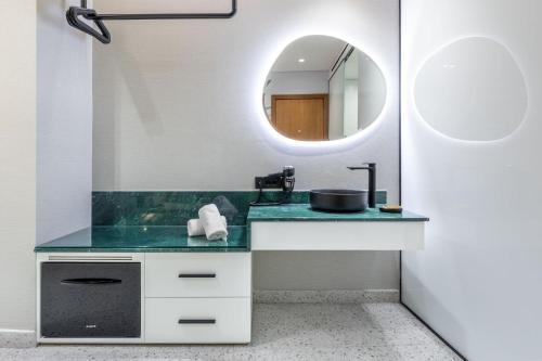 A bathroom at Amazon Hotel