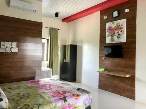 A bed or beds in a room at Nuwono Tasya Syariah