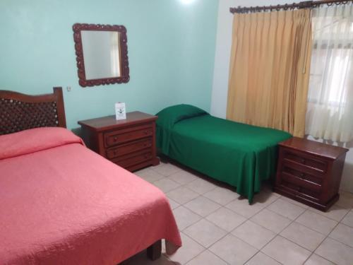 Cama o camas de una habitación en Hotel Brennan