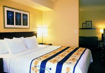 A bed or beds in a room at SpringHill Suites Prince Frederick