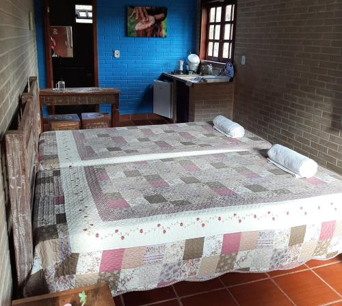 A bed or beds in a room at Espaço Puri