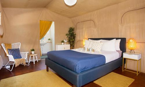 A bed or beds in a room at The Beachcamp Eco Retreat