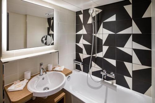 A bathroom at Zurich Swiss Chocolate by Fassbind