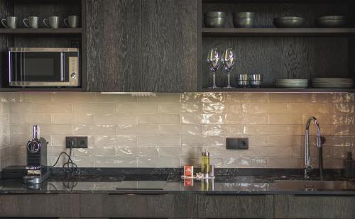 A kitchen or kitchenette at Black Beach Suites