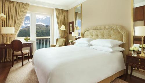 A bed or beds in a room at Badrutt's Palace Hotel St Moritz