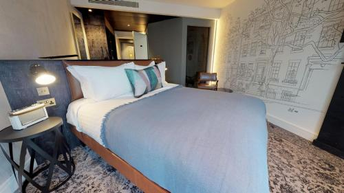 A bed or beds in a room at Hotel Brooklyn