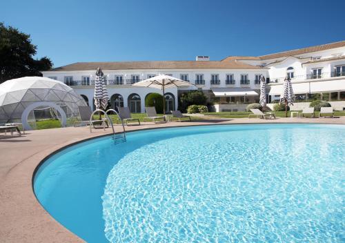 The swimming pool at or near Montebelo Principe Perfeito Viseu Garden Hotel
