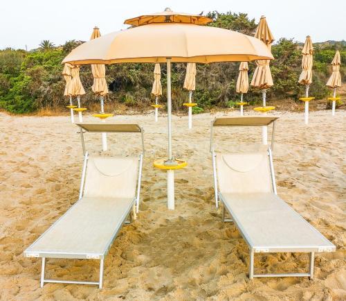 """Ein Kinderspielbereich in der Unterkunft """"SARDESIDENCE"""" Spiaggia Privata WiFi Parcheggio Riservato"""