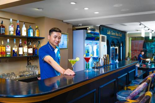 The lounge or bar area at Little Charm Hanoi Hostel - Homestay