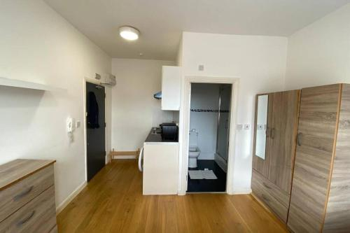 A television and/or entertainment center at Stoke Newington Cozy Area Private Studio Flat