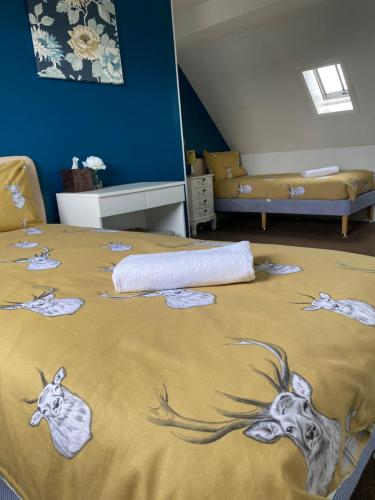 A bed or beds in a room at No 29 Inverness