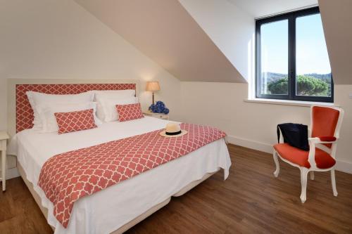 Cama ou camas em um quarto em Hotel Casa Palmela – Small Luxury Hotels (Hotel & Villas)