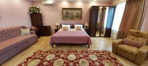 A bed or beds in a room at Tarasovo House