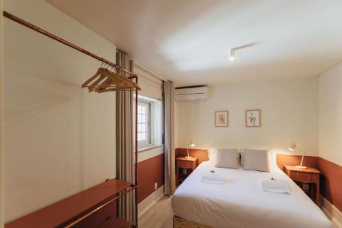 Кровать или кровати в номере Pergola Boutique Hotel