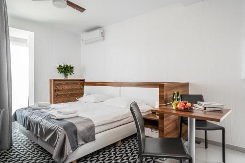 Posteľ alebo postele v izbe v ubytovaní Aparthotel Vanilla