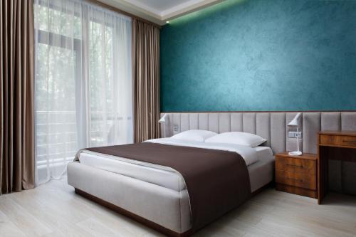 Кровать или кровати в номере Затерянный Рай у Машука