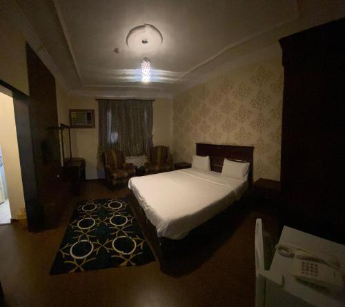Cama ou camas em um quarto em Inwan Residential Units