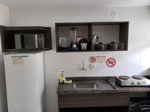 A cozinha ou cozinha compacta de Reserve Caldas Lacqua 3