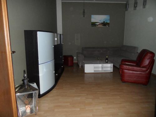 Telewizja i/lub zestaw kina domowego w obiekcie apartament