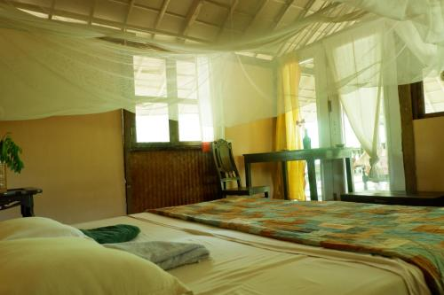 A bed or beds in a room at Khaama Kethna Eco Sustainable Village