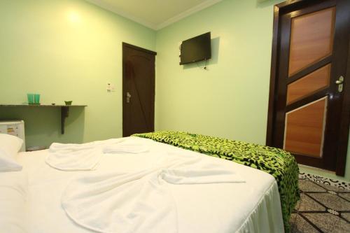 Cama o camas de una habitación en Hotel Lagoa
