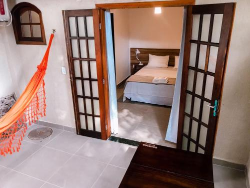 A bed or beds in a room at Pousada Mata Nativa