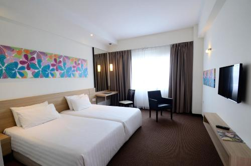 A bed or beds in a room at StarCity Hotel