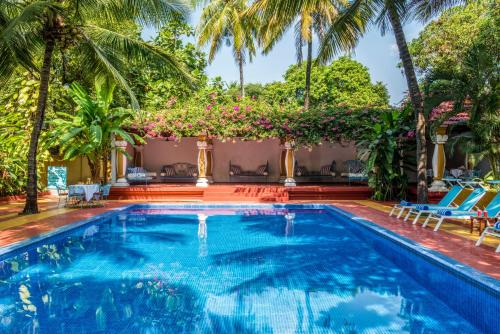 The swimming pool at or near Casa Anjuna