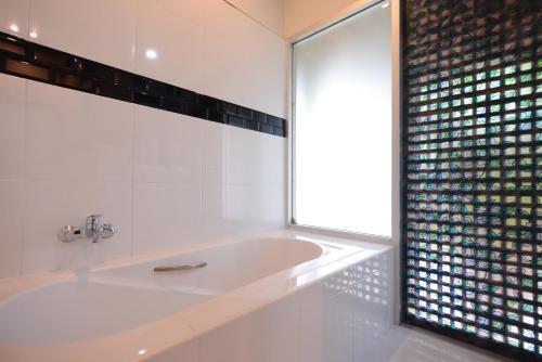 A bathroom at Royal River Kwai Resort and Spa