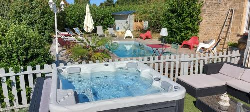 A view of the pool at Le Clos des Bories or nearby