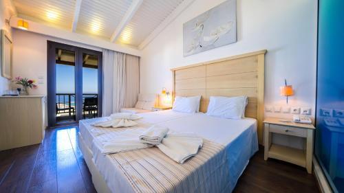 Ένα ή περισσότερα κρεβάτια σε δωμάτιο στο Forest Park Hotel
