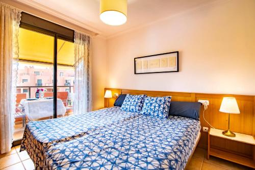 A bed or beds in a room at Sotavento Apartment. 1 Bedroom, 2º floor.