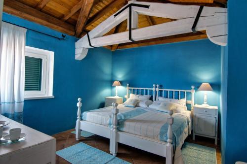 Letto o letti in una camera di Domus Corallia-Luxury Rooms