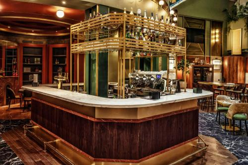 The lounge or bar area at MGallery Nest Paris La Défense Ex Sofitel