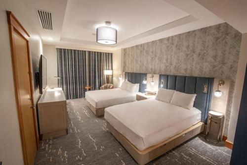 A bed or beds in a room at Summit Hotel at Big Sky Resort