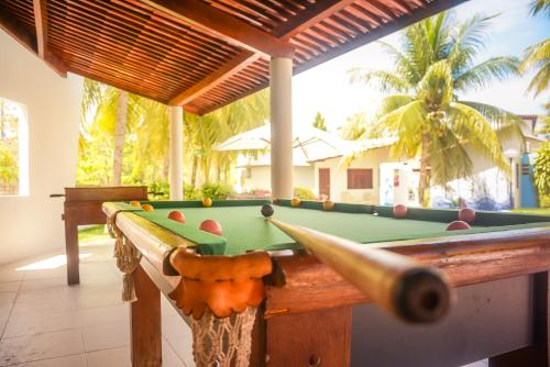 A billiards table at Bangalos do Pontal
