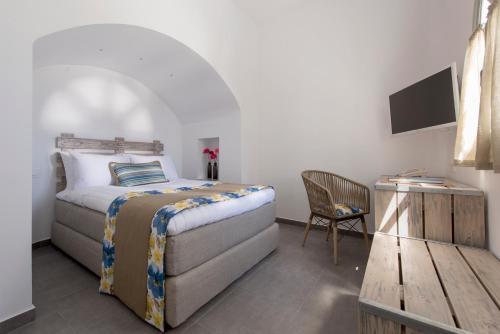 Vuode tai vuoteita majoituspaikassa Caldera's Dolphin Suites