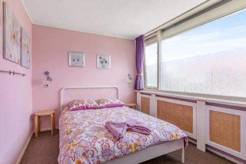 Een bed of bedden in een kamer bij Holiday Home Paolo's Place