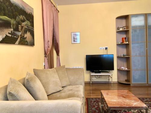 Телевизор и/или развлекательный центр в Апартаменты в историческом центре