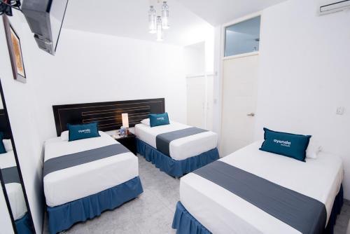 A bed or beds in a room at Ayenda Sol de Piura