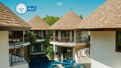 A view of the pool at Bangsak Village - Adults Only - SHA Plus or nearby
