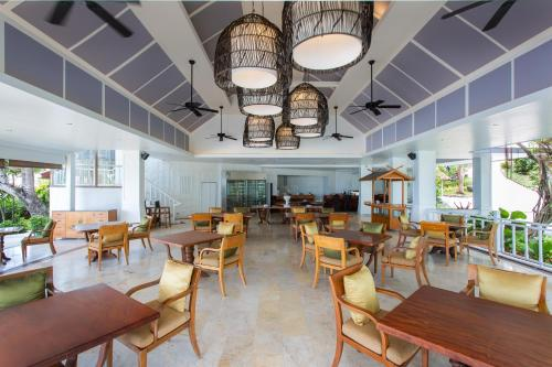 A restaurant or other place to eat at Rocky's Boutique Resort - SHA Plus