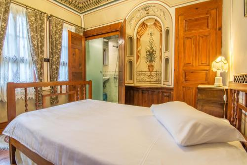 A bed or beds in a room at Hotel Residence Hebros
