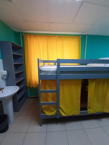 """A bunk bed or bunk beds in a room at Хостел """"Смородина-НСК"""""""