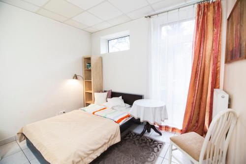 Posteľ alebo postele v izbe v ubytovaní Akacja Pokoje Gościnne