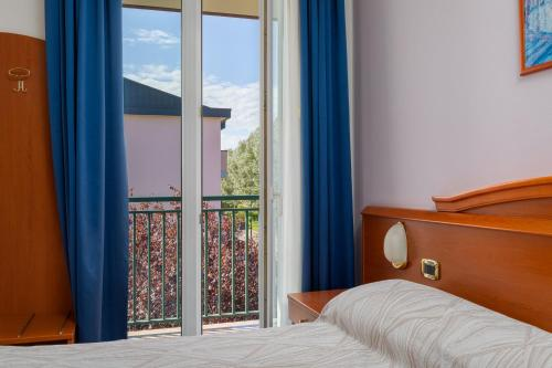 Ein Bett oder Betten in einem Zimmer der Unterkunft Hotel Palladio