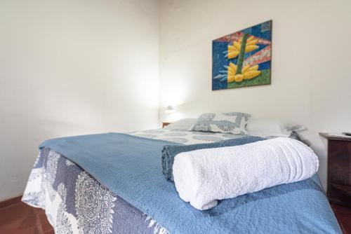 A bed or beds in a room at Pousada da Gibinha