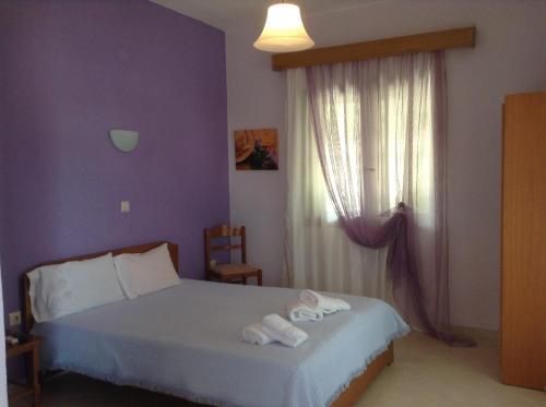 Кровать или кровати в номере Pansion Eleni