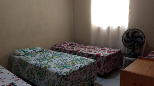 A bed or beds in a room at Vivenda Malu